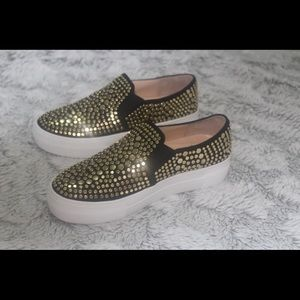 Vince Camuto black and gold sneakers